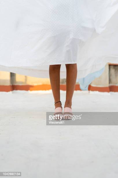 legs of young woman hiding behind drying bed sheet - sandal stock pictures, royalty-free photos & images