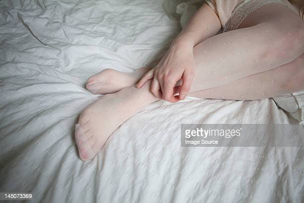legs of young woman on bed - beautiful women in pantyhose stock photos and pictures
