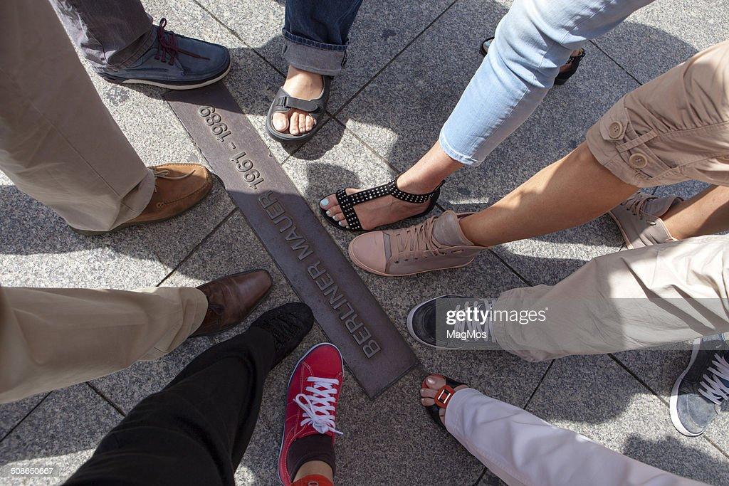 Legs on Berlin Wall memorial : Stock Photo