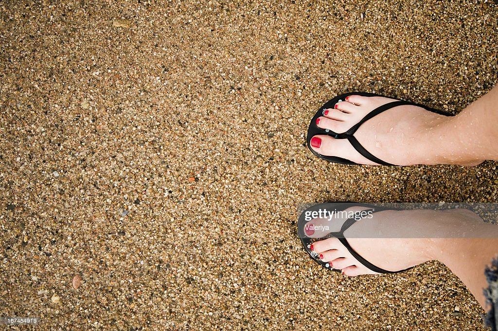 legs on sandy beach : Stock Photo