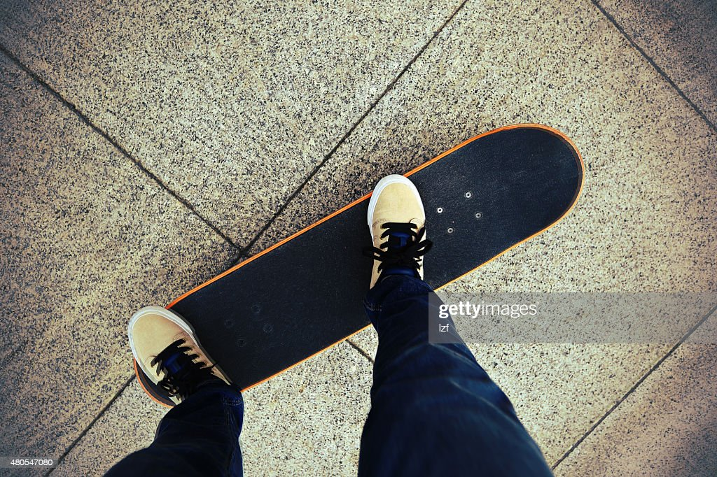 legs riding on skateboard : Stock Photo