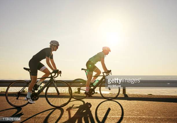legs speak louder than words - cycling stock pictures, royalty-free photos & images