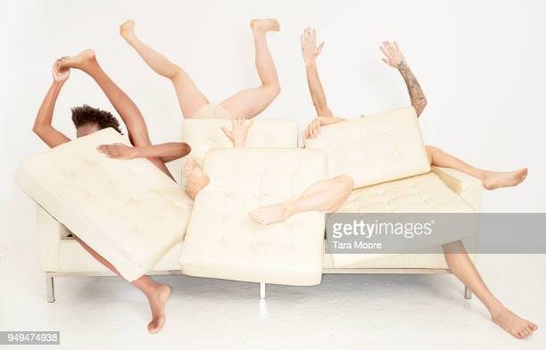 legs sticking out of sofa - limb body part stock pictures, royalty-free photos & images