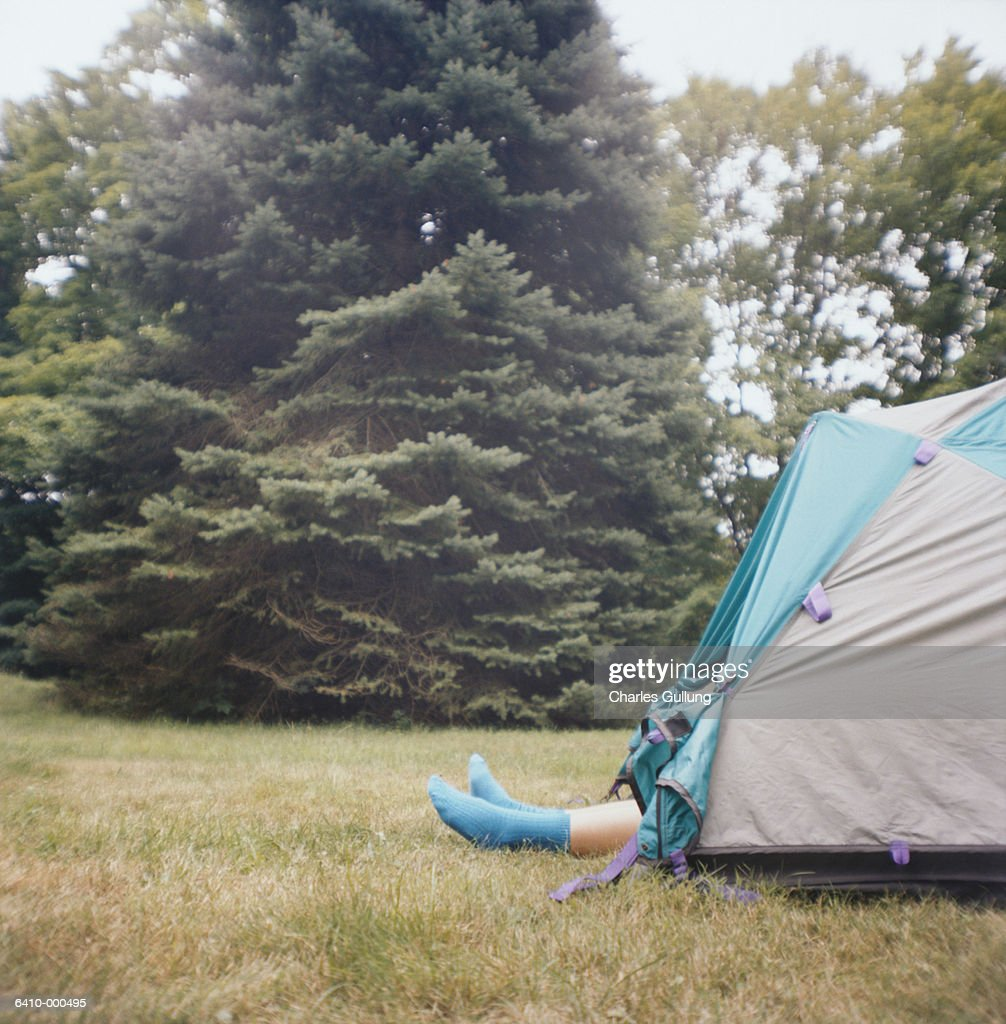 Legs Sticking out of Tent  Stock Photo & Legs Sticking Out Of Tent Stock Photo | Getty Images
