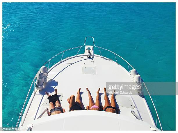 legs tanning on boat