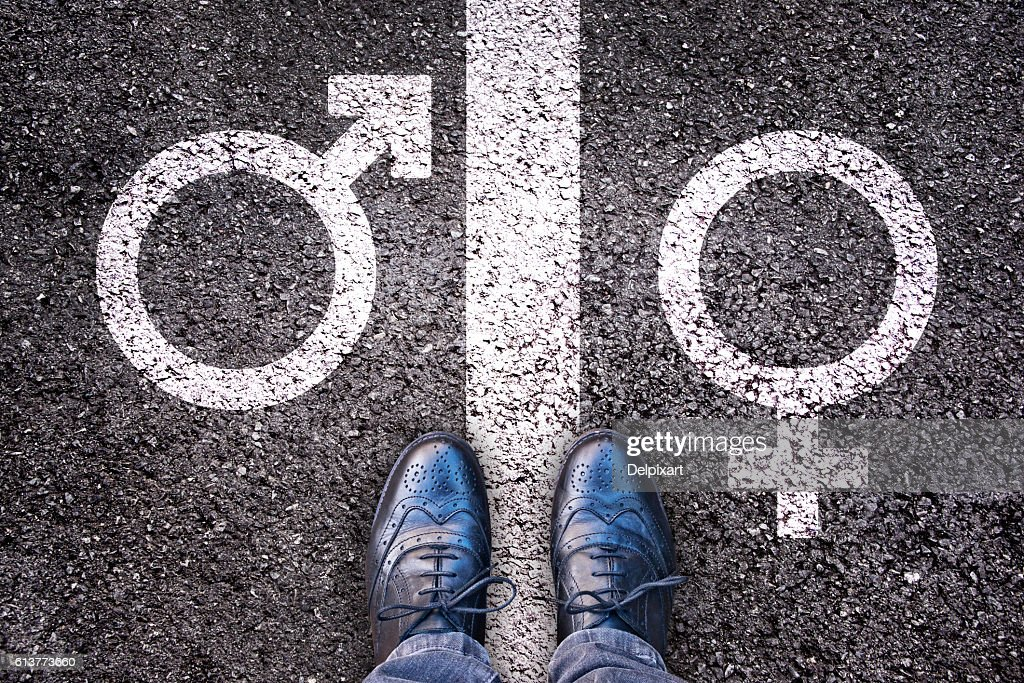 Legs with gender symbol on asphalt, gender concept : Stock Photo