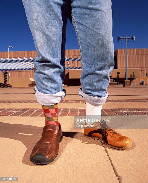 legs with mismatched socks and shoes - mismatch stock pictures, royalty-free photos & images