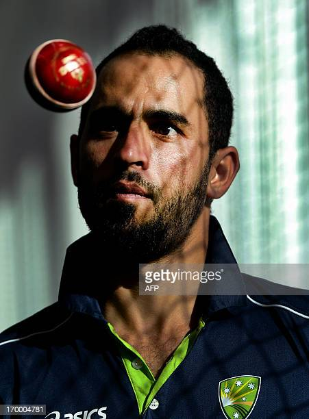 Legspinner Fawad Ahmed looks at a spinning ball at the indoor cricket nets at the MCG in Melbourne on June 6 after he was named to join the...