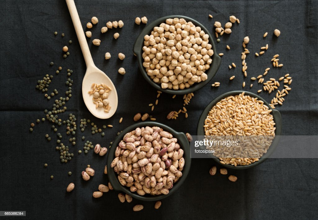 legume family in the black bowls on the table : Stock Photo