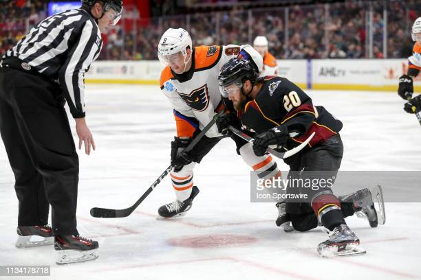 Lehigh Valley Phantoms center Cole Bardreau and Cleveland Monsters center Justin Scott battle for a faceoff during the third period of the American...