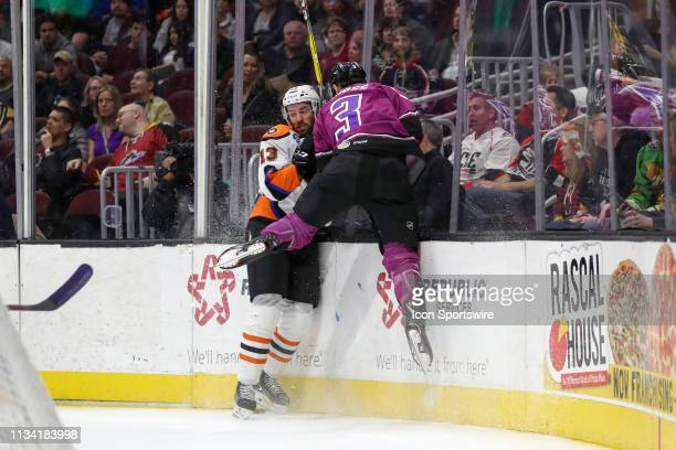 Lehigh Valley Phantoms right wing Colin McDonald and Cleveland Monsters defenceman Tommy Cross go into the boards as they battle for the puck during...