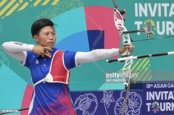 Lei ChienYing of Taiwan releases an arrow during the recurve women's team bronze medal match against Indonesia at the Asian Games 2018 test event in...