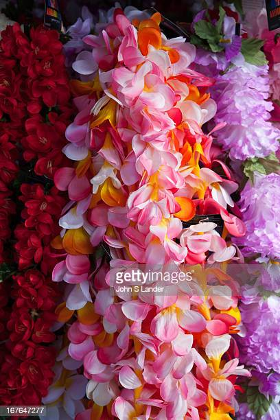 Lei is a Hawaiian word for a garland or wreath More loosely defined a lei is any series of objects strung together with the intent to be worn The...