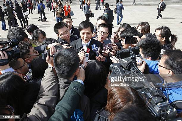 Lei Jun Chairman and CEO of Xiaomi Technology and Chairman of Kingsoft Corp talks to the media after the opening session of the National People's...