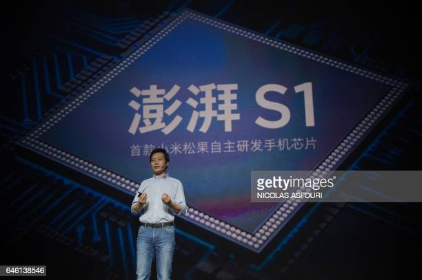 Lei Jun Chairman and CEO of Xiaomi Technology presents the new Surge S1 chipset at a launch event in Beijing on February 28 2017 Chinese technology...