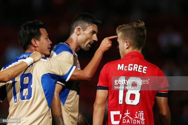 Lei Lei Ma and Jason Hoffman of the Jets has words with Riley McGree of Adelaide United after McGree's tackle on Ma sparked a melee during the round...