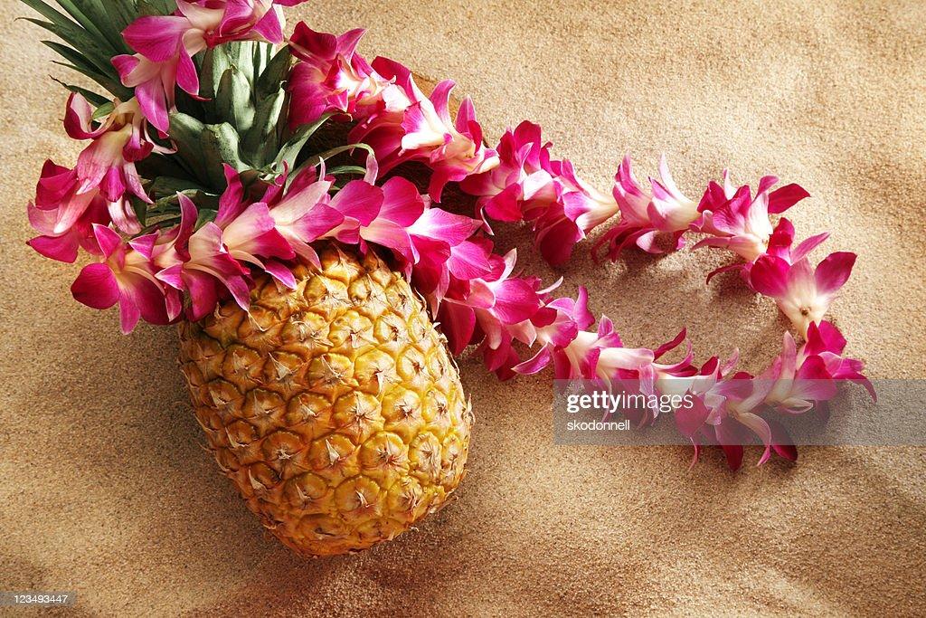 lei on pineapple at the beach : Stock Photo