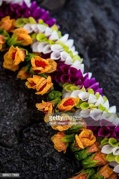a lei with colourful tropical flowers - lei day hawaii stock pictures, royalty-free photos & images