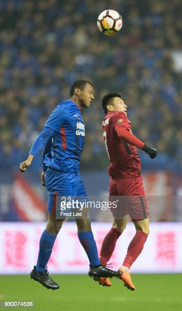 Lei wu of Shanghai SIPG and Eddy Francis of Shanghai Greenland Shenhua in action during the 2018 Chinese Super League match between Shanghai...