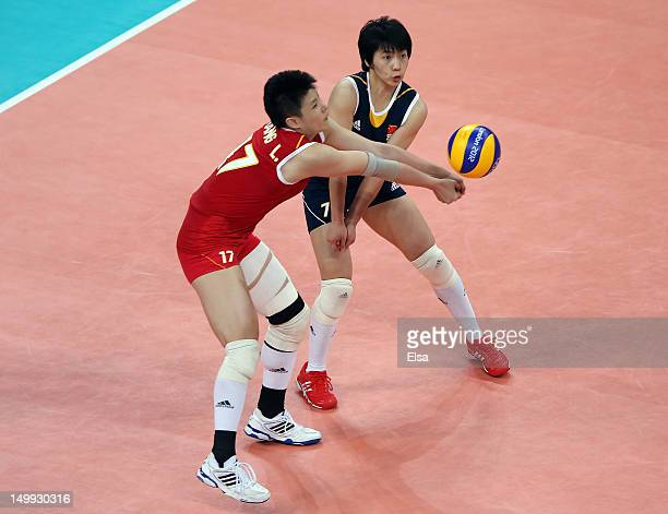 Lei Zhang and Xian Zhang of China go for the ball in the second set against Japan during Women's Volleyball on Day 11 of the London 2012 Olympic...