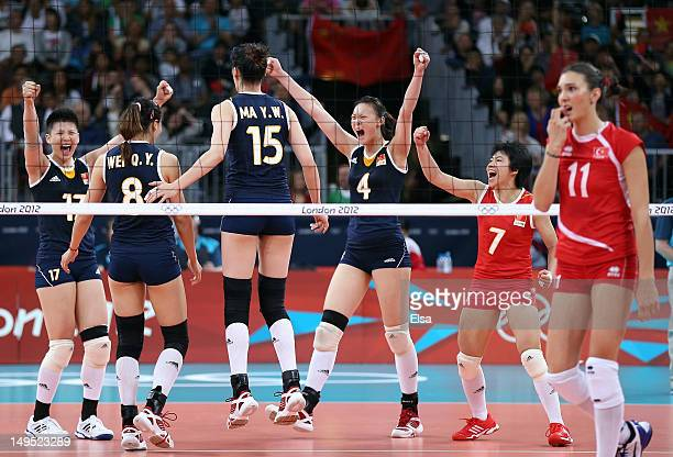 Lei ZhangQiuyue WeiYunwen MaRuoqi Hui and Xian Zhang of China celebrate a point in the second set as Naz Aydemir of Turkey walks by during Women's...