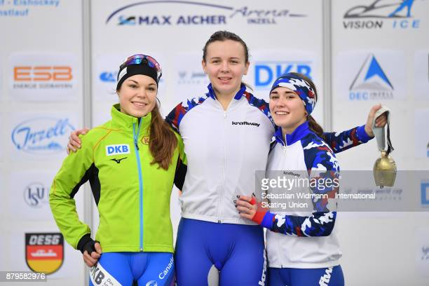 Leia Behlau of Germany Daria Kachanova of Russia and Veronika Suslova of Russia pose during the medal ceremony of the Ladies 1500 Meter at the ISU...