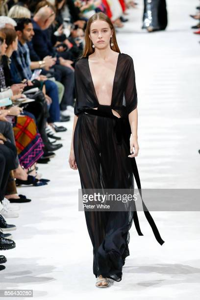 Leia Matagne walks the runway during the Valentino show as part of the Paris Fashion Week Womenswear Spring/Summer 2018 on October 1 2017 in Paris...