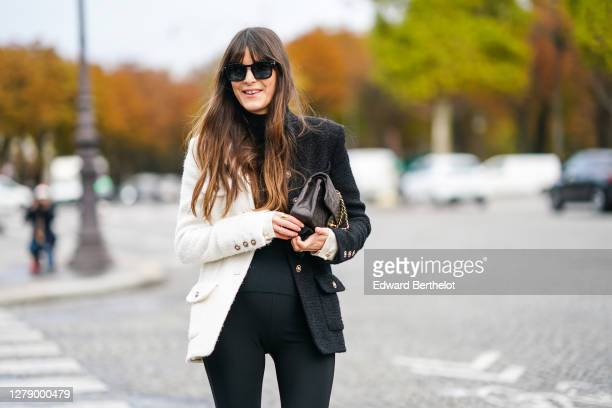 Leia Sfez wears sunglasses, a black and white jacket, a black pullover, black pants, a Chanel bag, outside Chanel, during Paris Fashion Week -...