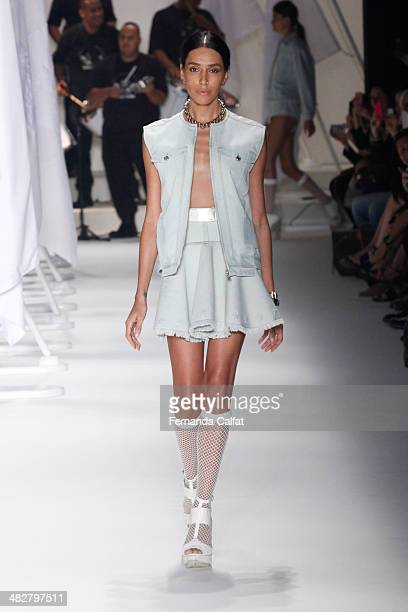 Leia T walks the runway during Ellus show at Sao Paulo Fashion Week Summer 2014/2015 at Parque Candido Portinari on April 4 2014 in Sao Paulo Brazil