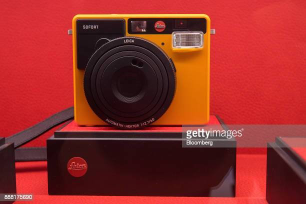 A Leica Sofort instant film camera sits on display in the showroom at the Leica Camera AG headquarters in Wetzlar Germany on Tuesday Nov 28 2017...