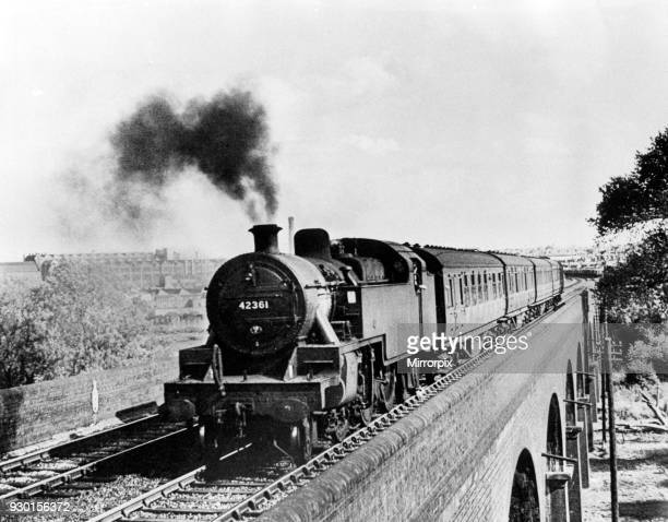 A Leicester based tank engine headed for its home city over the viaduct at Rugby circa 1964