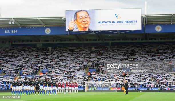 Leicester City and Burnley players along with fans pay tribute to the late Leicester City chairman Vichai Srivaddhanaprabha prior to the Premier...