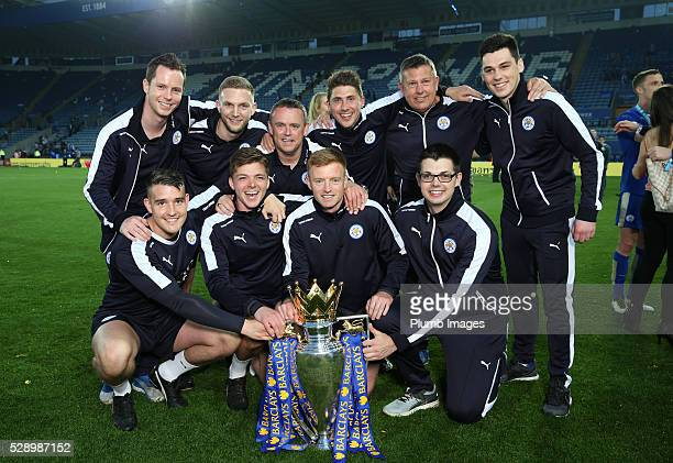 Leicester City back room staff with the Premier League trophy at the King Power Stadium on May 7th 2016 in Leicester United Kingdom