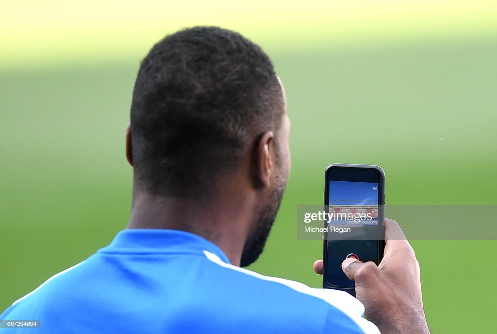 Leicester City Captain Wes Morgan uses snapchat inside the stadium during a Leicester City training session ahead of their UEFA Champions League Quarter-Final match against Atletico Madrid at Vicente Calderon Stadium on April 11, 2017 in Madrid, Spain.