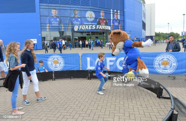 Leicester City club mascot Filbert Fox has a kick about with some young Leicester City fans outside King Power Stadium ahead of the Premier League...