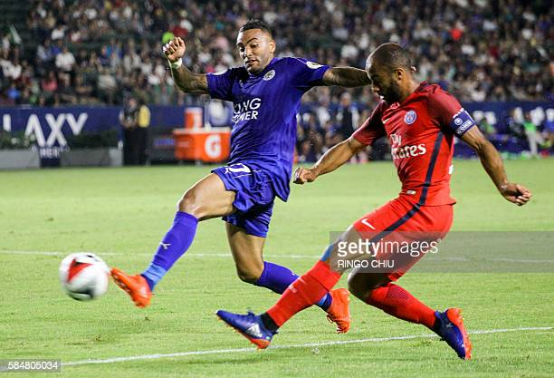 Leicester City defender Danny Simpson and Paris SaintGermain midfielder Lucas Moura battle for the ball during their International Champions Cup...