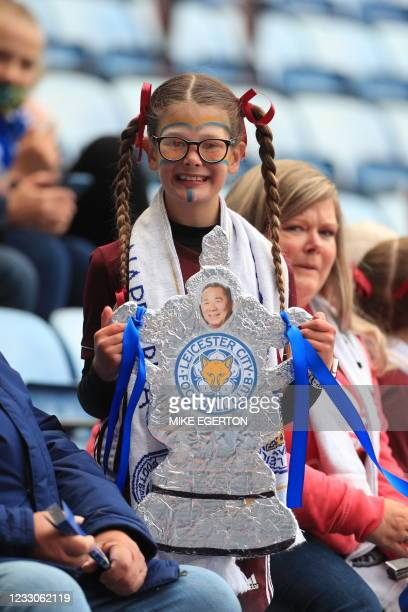 Leicester City fan holds a home made FA Cup with a picture of Leicester City's late Thai chairman Vichai Srivaddhanaprabha ahead of the English...