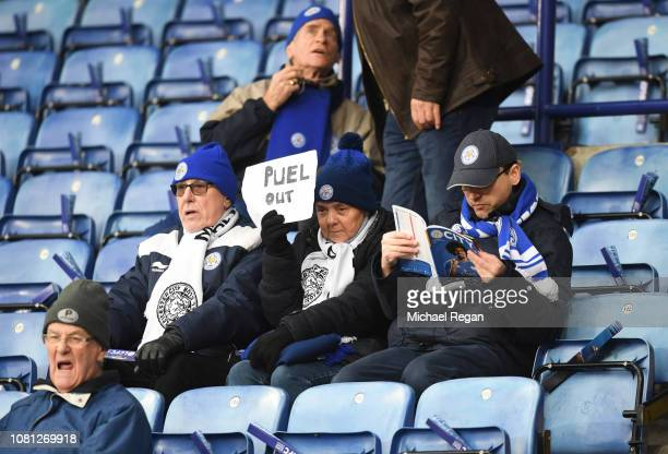Leicester City fan holds up a 'Puel Out' sign prior to the Premier League match between Leicester City and Southampton FC at The King Power Stadium...