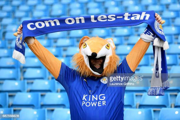 Leicester City fan poses for a photograph with their scarf inside the stadium prior to the Premier League match between Manchester City and Leicester...
