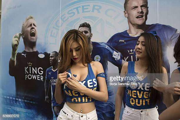 Leicester city fan puts a sticker on her body before watching her team plays against Manchester United on May 1 2016 in Bangkok Thailand Leicester...