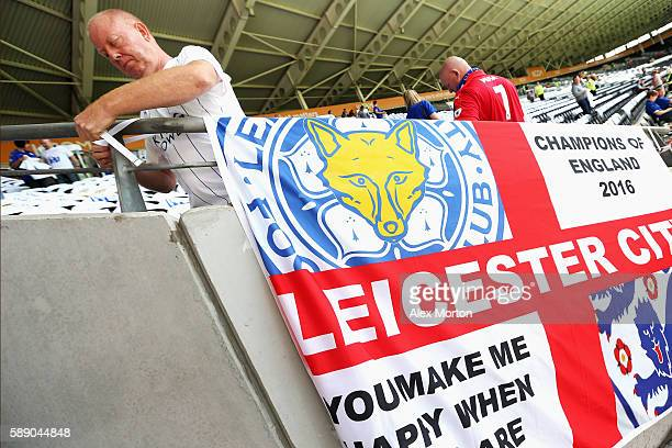 Leicester City fan puts up his flag pre match during the Premier League match between Hull City and Leicester City at KCOM Stadium on August 13 2016...