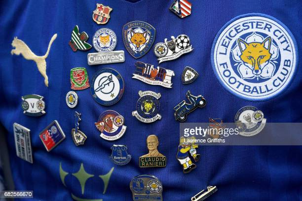 Leicester City fan shirt is seen with badges on prior to the Premier League match between Manchester City and Leicester City at Etihad Stadium on May...