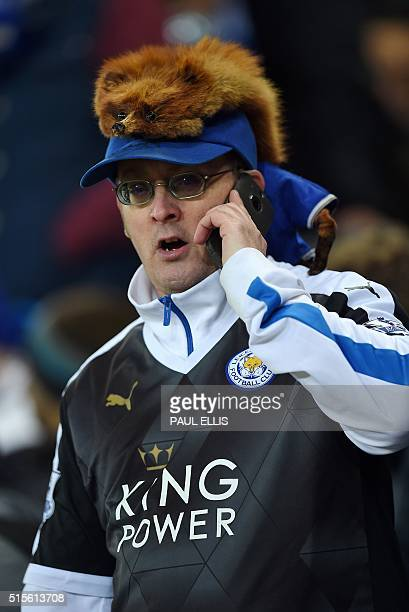A Leicester City fan watches his team play against Newcastle during the English Premier League football match between Leicester City and Newcastle at...