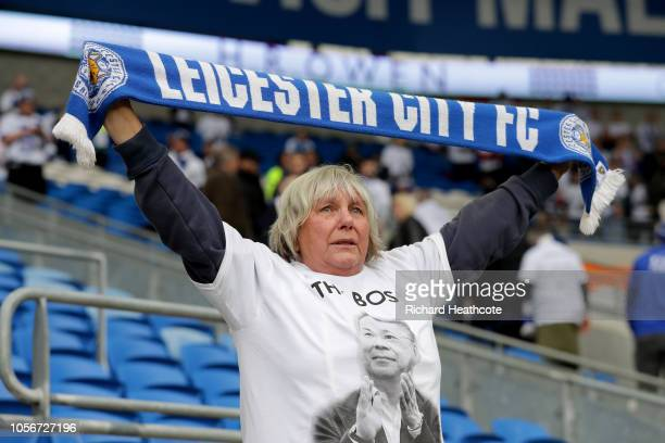 Leicester City fan wearing a commemorative tshirt in memory of Vichai Srivaddhanaprabha holds up a scarf prior to the Premier League match between...