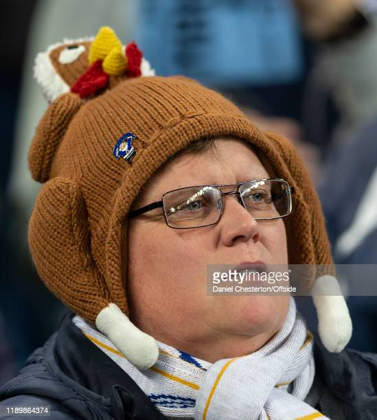 Leicester City fan wears a Christmas hat during the Premier League match between Manchester City and Leicester City at Etihad Stadium on December 21,...