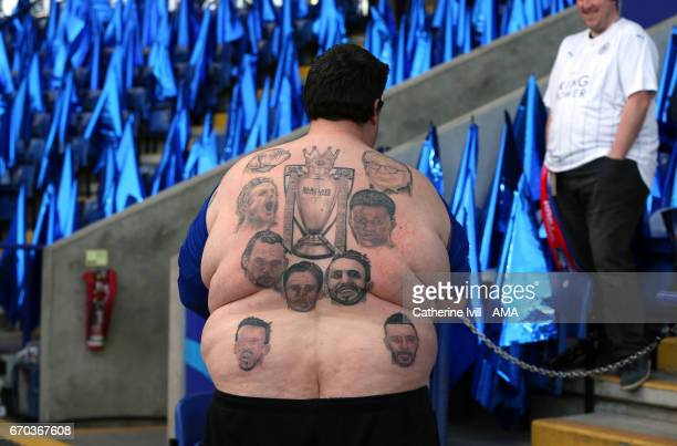 Leicester City fan with tattoos on his back on the Premier League trophy Claudio Ranieri Jamie Vardy Riyad Mahrez and Leicester City players during...