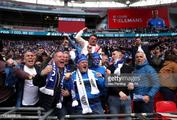 Leicester City fans celebrate after Youri Tielemans scores their sides first goal during The Emirates FA Cup Final match between Chelsea and...