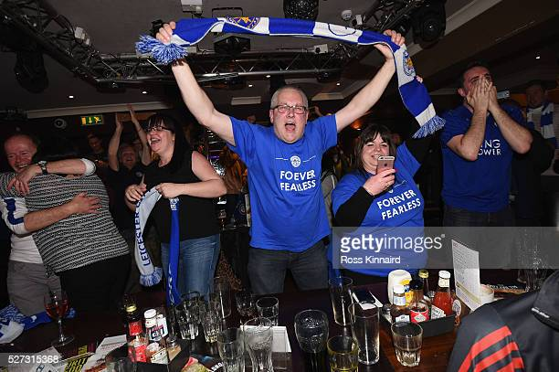 Leicester City fans celebrate as their team becomes Premier League champions after watching the Barclays Premier League between Chelsea and Tottenham...
