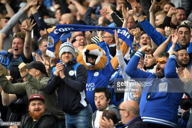 Leicester City fans celebrate during the Premier League match between Everton and Leicester City at Goodison Park on April 9 2017 in Liverpool England