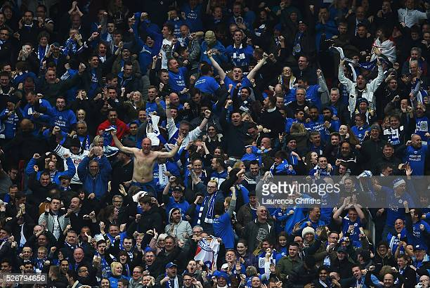 Leicester City fans celebrate the goal scored by Wes Morgan during the Barclays Premier League match between Manchester United and Leicester City at...